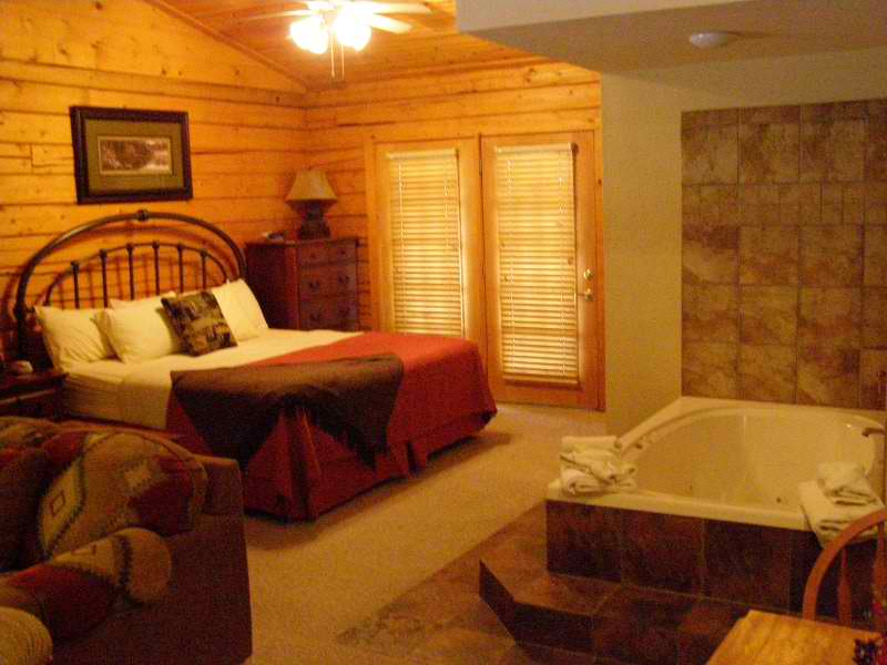 One Bedroom Cabin with Jacuzzi Logo